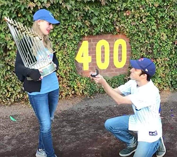 Die-Hard Cubs Fans Live a Dream, Get Engaged While Holding the World Series Trophy at Wrigley Field